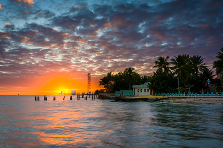 key of paradise: Sunset over the Gulf of Mexico from the Southernmost Point in Key West, Florida.