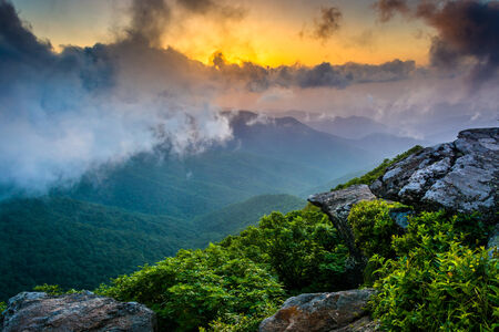 Sunset through fog, seen from Craggy Pinnacle, near the Blue Ridge Parkway, North Carolina. photo