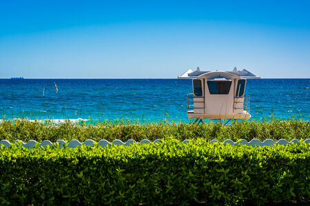 in palm: Lifeguard station and the Atlantic Ocean in Palm Beach, Florida. Stock Photo