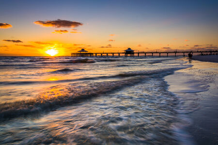 gulf of mexico: Sunset over the fishing pier and Gulf of Mexico in Fort Myers Beach, Florida.