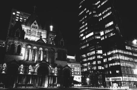 hancock building: Trinity Church and the John Hancock Building at night, at Copley Square in Boston, Massachusetts. Stock Photo