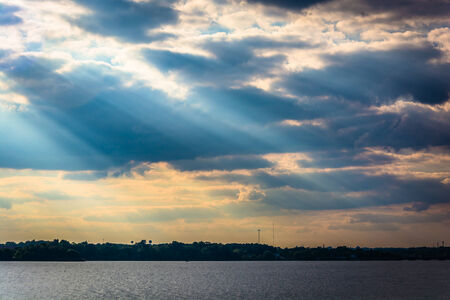 crepuscular: Crepuscular rays over the Back River seen from Cox Point Park, Essex, Maryland.