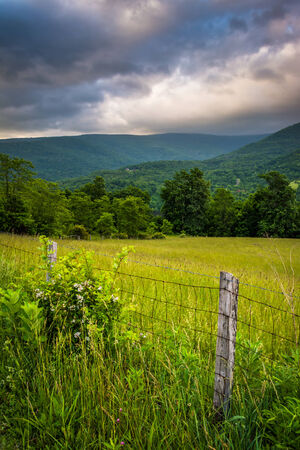 allegheny: Fence and morning view of mountains in the rural Potomac Highlands of West Virginia.