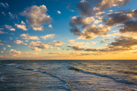 gulf of mexico: Sunset sky over waves in the Gulf of Mexico, in  Naples, Florida. Stock Photo
