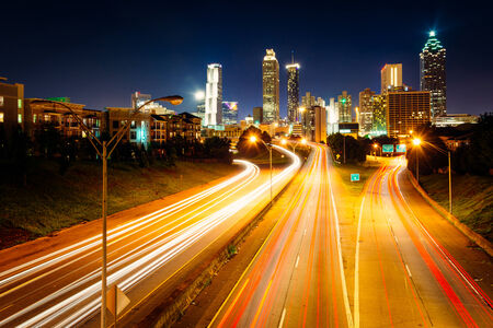 Traffic on Freedom Parkway and the Atlanta skyline at night, seen from the Jackson Street Bridge in Atlanta, Georgia. photo