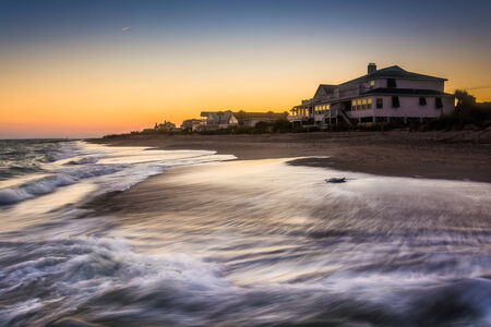 beachfront: Waves in the Atlantic Ocean and beachfront homes at sunset, Edisto Beach, South Carolina.