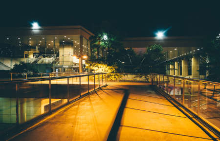 elevated walkway: Elevated walkway and buildings at night in Baltimore, Maryland. Stock Photo