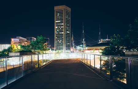 elevated walkway: Elevated walkway and the World Trade Center at night in Baltimore, Maryland.