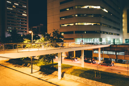elevated walkway: Elevated walkway over Charles Street at night in Baltimore, Maryland.