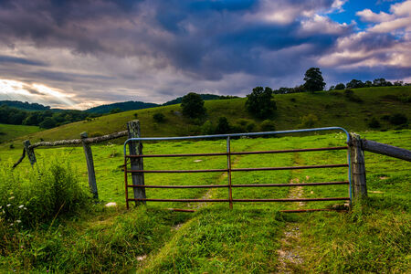 north gate: Gate in a field at Moses Cone Park on the Blue Ridge Parkway in North Carolina. Stock Photo