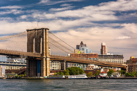 The Brooklyn Bridge, over the East River, seen from Pier 15, Manhattan, New York. Stock Photo - 34999996