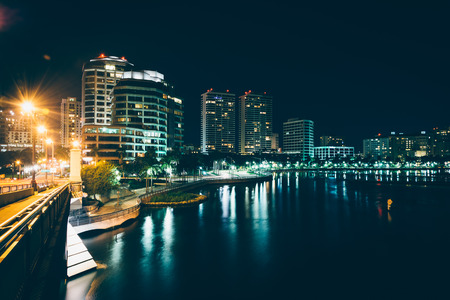 florida landscape: The West Palm Beach skyline seen from the Royal Palm Bridge at night, in West Palm Beach, Florida.