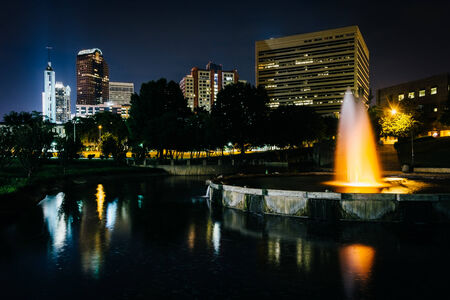 The Charlotte skyline and fountain seen at Marshall Park, in Charlotte, North Carolina. photo