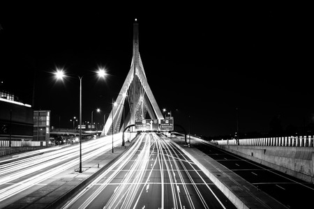 Traffic moving over the Leonard P. Zakim Bunker Hill Memorial Bridge at night, in Boston, Massachusetts. photo