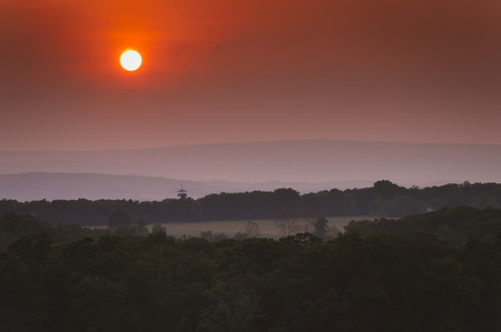 appalachian mountains: Hazy sunset over the Appalachian Mountains from Little Round Top, in Gettysburg, Pennsylvania. Stock Photo