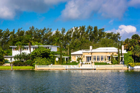 canal house: Houses along Collins Canal in Miami Beach, Florida. Stock Photo