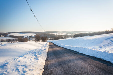 covered fields: Snow covered fields along a country road in rural York County, Pennsylvania.