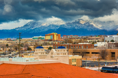View of distant mountains and buildings in Albuquerque, New Mexico.