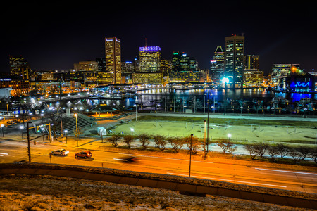 View of the Baltimore skyline and Inner Harbor at night, seen from Federal Hill, Baltimore, Maryland.