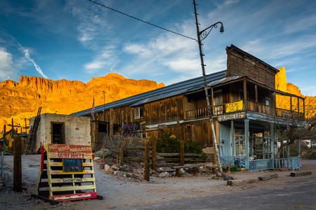 Evening light on a building and mountains in Oatman, Arizona. Editöryel