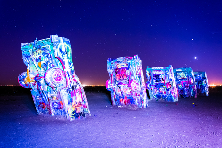The Cadillac Ranch at night, along Historic Route 66 in Amarillo, Texas. Editorial