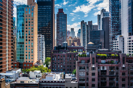 new building: View of buildings in the Turtle Bay neighborhood, from a rooftop on 51st Street in Midtown Manhattan, New York.
