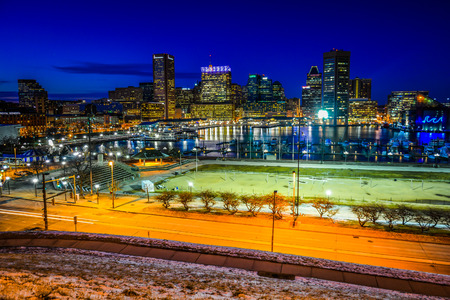 harbors: View of the Baltimore skyline and Inner Harbor at night, seen from Federal Hill, Baltimore, Maryland. Stock Photo