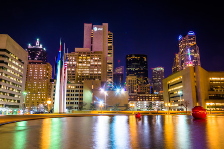 dallas: The Dallas skyline and the reflecting pool at City Hall at night, in Dallas, Texas. Stock Photo