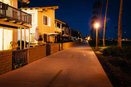 oceanfront: Buildings along the Oceanfront Boardwalk at night, in Newport Beach, California.