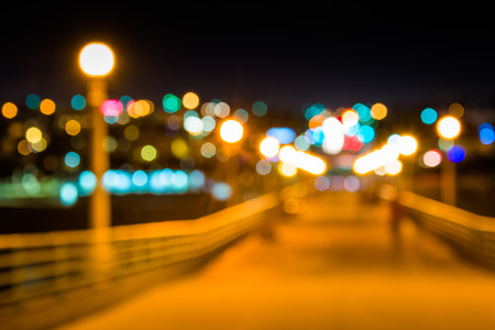Colorful bokeh background taken at the pier at night, in Manhattan Beach, California. photo
