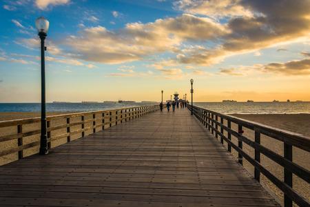 california beach: The pier at sunset, in Seal Beach, California. Stock Photo