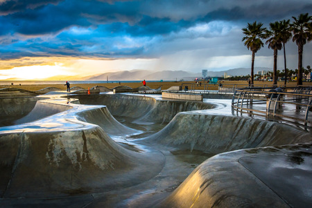 The Venice Skate Park at sunset, in Venice Beach, Los Angeles, California.