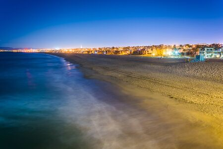 View of the beach at night, from the pier in Hermosa Beach, California.
