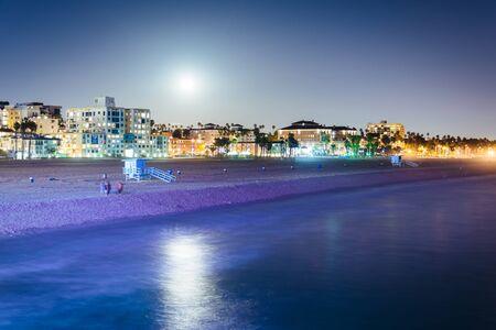 monica: Moonrise over the beach in Santa Monica, California.