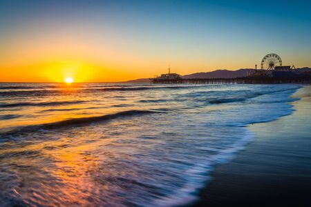 monica: Sunset over the Pacific Ocean and Santa Monica Pier, in Santa Monica, California.