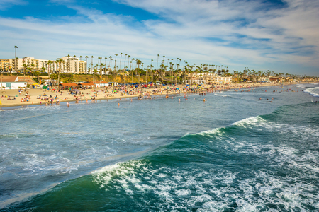 oceanside: View of the beach and waves in the Pacific Ocean from the pier in Oceanside, California.