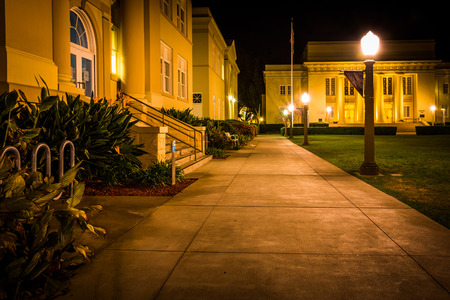 chapman: Walkway and buildings at night, at Chapman University, in Orange, California.