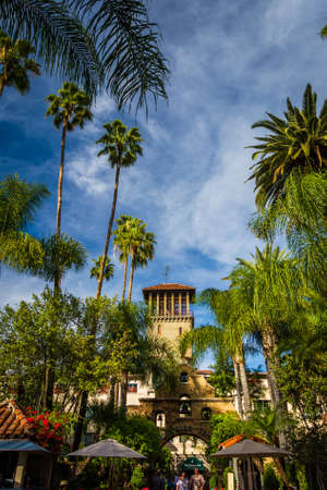 riverside trees: Palm trees and the exterior of the Mission Inn, in Riverside, California. Editorial