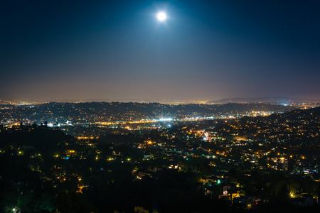 griffith: The moon over Northeast Los Angeles at night, seen from Griffith Observatory, in Griffith Park, Los Angeles, California.
