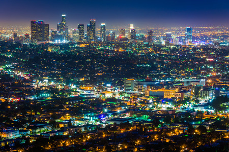 city park skyline: View of the downtown Los Angeles skyline at night, from Griffith Observatory, in Griffith Park, Los Angeles, California. Stock Photo