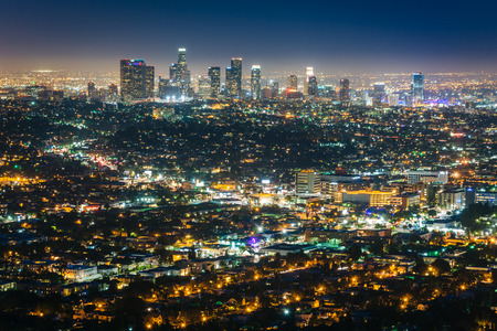 light in dark: View of the downtown Los Angeles skyline at night, from Griffith Observatory, in Griffith Park, Los Angeles, California. Stock Photo
