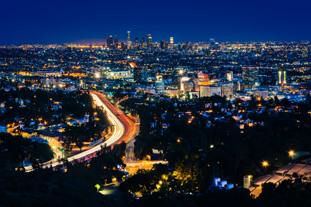 overlook: View of the Los Angeles Skyline and Hollywood at night from the Hollywood Bowl Overlook, in Los Angeles, California.