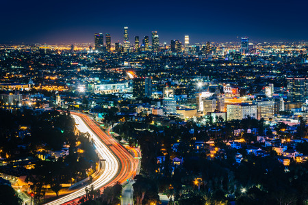 View of the Los Angeles Skyline and Hollywood at night from the Hollywood Bowl Overlook, in Los Angeles, California.