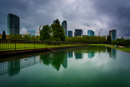 bellevue: The skyline reflecting in a pond, at Downtown Park, in Bellevue, Washington.