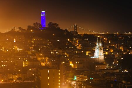 coit tower: View of the Coit Tower at night, from Russian Hill, in San Francisco, California. Stock Photo