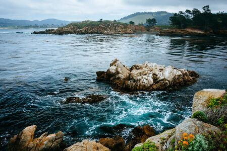 ocean state: View of rocks and waves in the Pacific Ocean at Point Lobos State Natural Reserve, in Carmel, California. Stock Photo