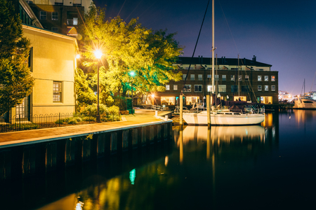 fells: Boat and waterfront promenade in Fells Point at night, Baltimore, Maryland. Stock Photo