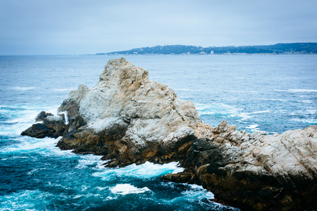 ocean state: Waves and rocks in the Pacific Ocean, at Point Lobos State Natural Reserve, California.