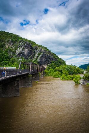west river: Pedestrian bridge over the Potomac River, seen in Harpers Ferry, West Virginia. Stock Photo