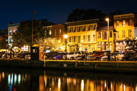fells: Shops and restaurants at night in Fells Point, Baltimore, Maryland. Editorial